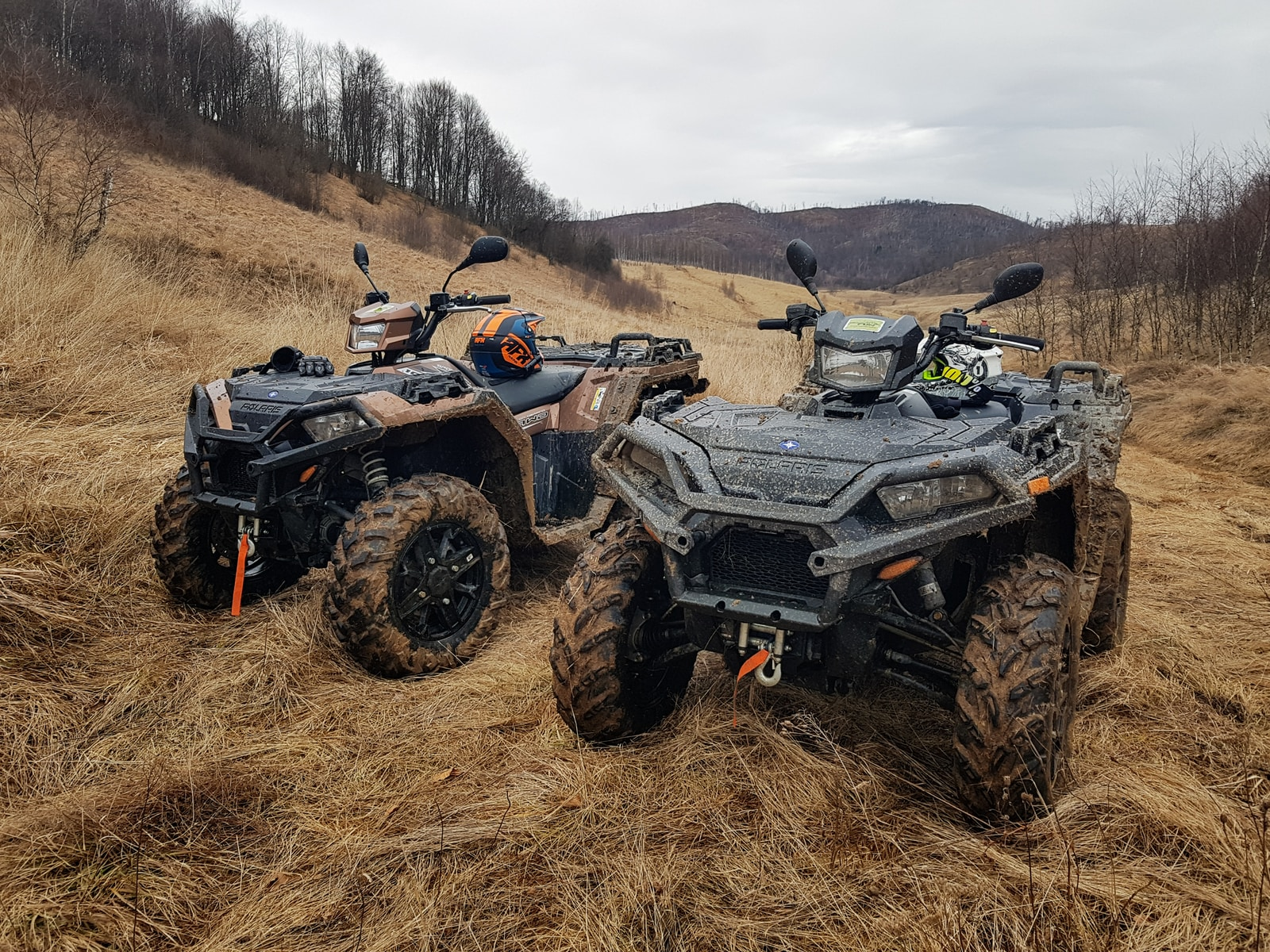 black and gray atv on brown field during daytime